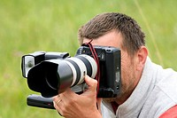 Photographer, camera, lightning, telephoto lens, photographs