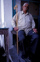 N  E  Aegean, Lesvos Agiasos, portrait of old man in moustache holding walking stick glitsa