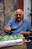 Owner of Refik tavern preparing string beans, Istanbul, Turkey, Middle East ,