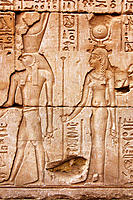 Stone relief of Isis and Horus at the temple of Horus in Edfu. Egypt