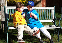 Young boys drinking juice together