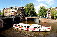 Water taxi on canal. Amsterdam. Holland