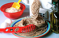 Whole wheat pasta with pasta machine and ingredients