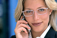 Businesswoman talking on cell phone, close up