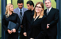 Businesspeople in conference , businesswoman looking at camera
