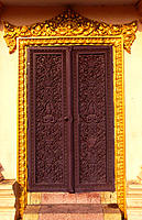 Wooden doors with carvings. Phnom Penh. Cambodia