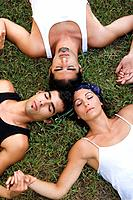 Men, woman, young, grass, lying, circle, closed eyes, top view,