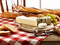 Assortment of cheese and baguette