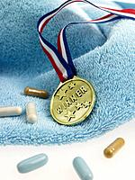 Medal and capsules on a towel