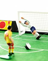 Two soccer figurines