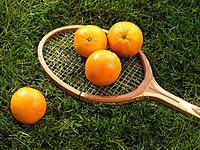 Oranges on Tennis Racket