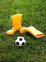 Rubber boots and soccer ball