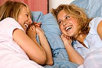 Two teenage girls lying down