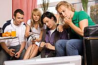 Four teenagers playing video game (thumbnail)