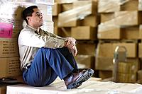 Man Taking Work Break in Warehouse