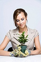 Businesswoman Holding Plant