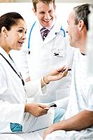 Doctors Talking to Patient