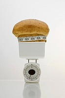 A loaf of bread on weight scales