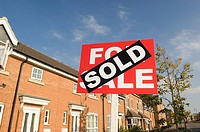 Sold sign and houses