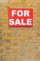 For sale sign on wall