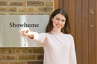Young woman outside show home