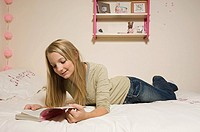 Girl reading a book in room