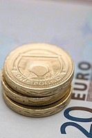 Pound coins on euro note (thumbnail)