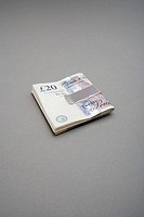 Twenty pound notes in money clip (thumbnail)