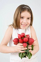 Girl holding radishes