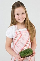 Girl with tray of cress