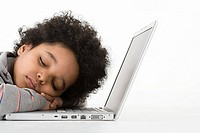 Boy asleep on laptop