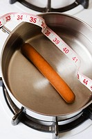 Boiling a frankfurter in a saucepan