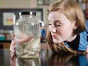 Girl with frog in jar