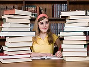 Girl with stacks of books
