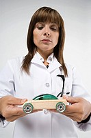 Scientist holding toy car