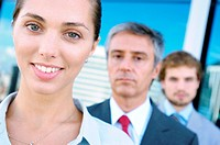 Business people standing in row, smiling, portrait (thumbnail)