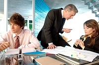 Businessman discussing with colleagues in office (thumbnail)