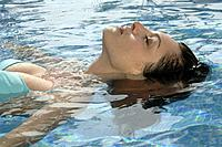 Woman is swimming backstroke