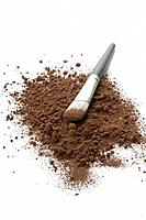 Chocolate powder and a brush