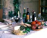 Mediterranean buffet with bread, cheese, cold meat and wine
