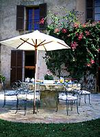 Breakfast table on the terrace with parasol