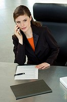 Businesswoman talking on a mobile phone in an office
