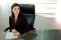 Businesswoman sitting at a desk in an office