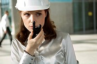 Close-up of a young woman talking on a walkie-talkie (thumbnail)