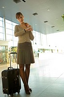 Low angle view of a businesswoman checking the time at an airport