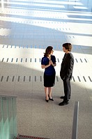 High angle view of a businesswoman talking with a businessman