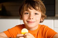 Portrait of a boy holding cheese