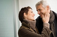 Close_up of a mid adult woman and a mature man romancing