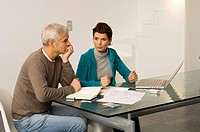 Mature man and a mid adult woman planning their finances