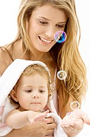 Close-up of a young woman and her son playing with soap bubbles (thumbnail)
